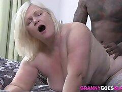 Mature slut riding fat black cock
