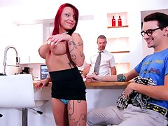 Redhead escort Ariana Skyy drops her clothes to ride two dudes