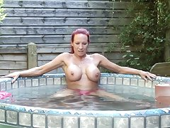 Busty grown up redhead MILF Faye exposes her conceitedly firm tits