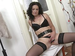 Solo MILF brunette model Maika takes wanting her clothes and masturbates