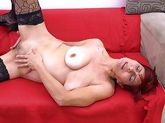 Shorthaired redhead mature amateur MILF Pauletta S. strips seductively