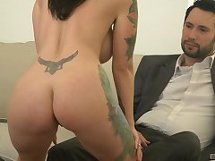 tattooed milf Dolly Darko is ready for everlasting sex with her friend on the love-seat