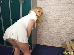 Big-busted MILF has the looks and she gives a hot upskirt view in the locker room