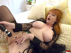 Redhead mature Overheated XXX gets off with their way toy