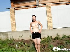 Provocative open-air action with a very busty raunchy mature