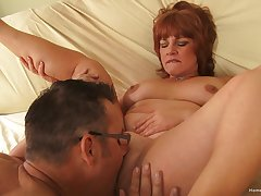 Amateur grown up tries younger dick in her fat holes