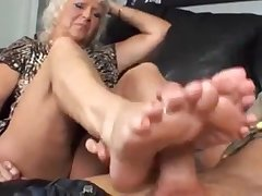 Blonde granny jerks gone a stiff horseshit with her feet
