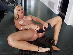 Saleable MILF Sandy uses a huge fake ebon dick in her clam