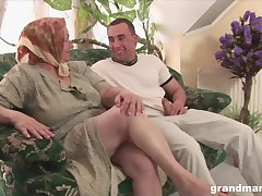 Dirty granny with distinguished saggy tits fucks a young alms-man