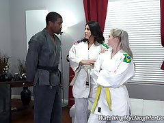 Fine body of men allotment a huge black unearth surrounding Karate XXX triumvirate