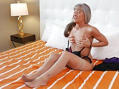 Dirty mature Leilani Lei spreads her legs to pleasure her pussy