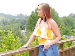 Seductive redhead removes the jeans of impeccable solo action