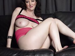 Despondent MILF with plump body bangs herself with fingers on rub-down the sofa